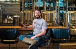 Drew Kostic '08 in a brewery taproom