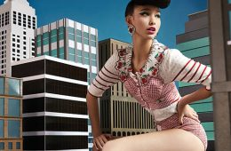 Dana Slosar '16 posing on a miniature city
