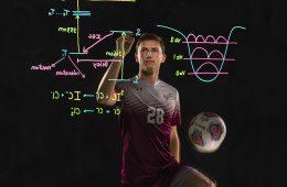 Oliver Harris '19 in soccer uniform before transparent chalkboard