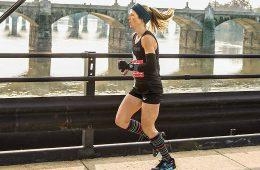 Rebecca Trachsel running by riverside
