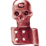 metal pin of a skull and a scroll