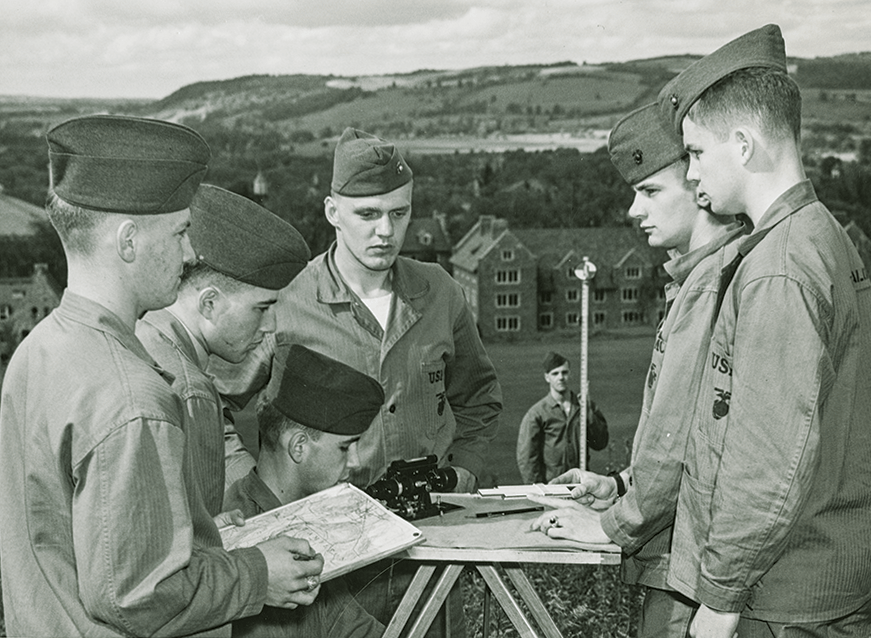 Colgate students in the Marines gathered around a paper map