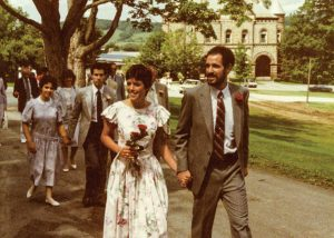 Deborah Springhorn and Steve Silver at their wedding, with James B. Colgate Hall in the background