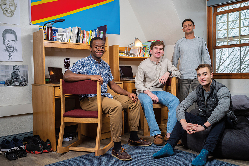 Thomas Dunia, Edward Bass, Ebrahim Almansob, and Jack Kohler in their dorm room