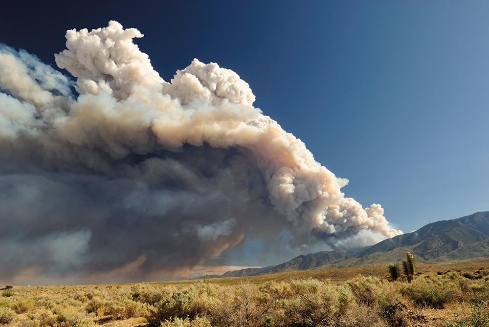Cloud of smoke from a forest fire in Sierra Nevada Mountains, California