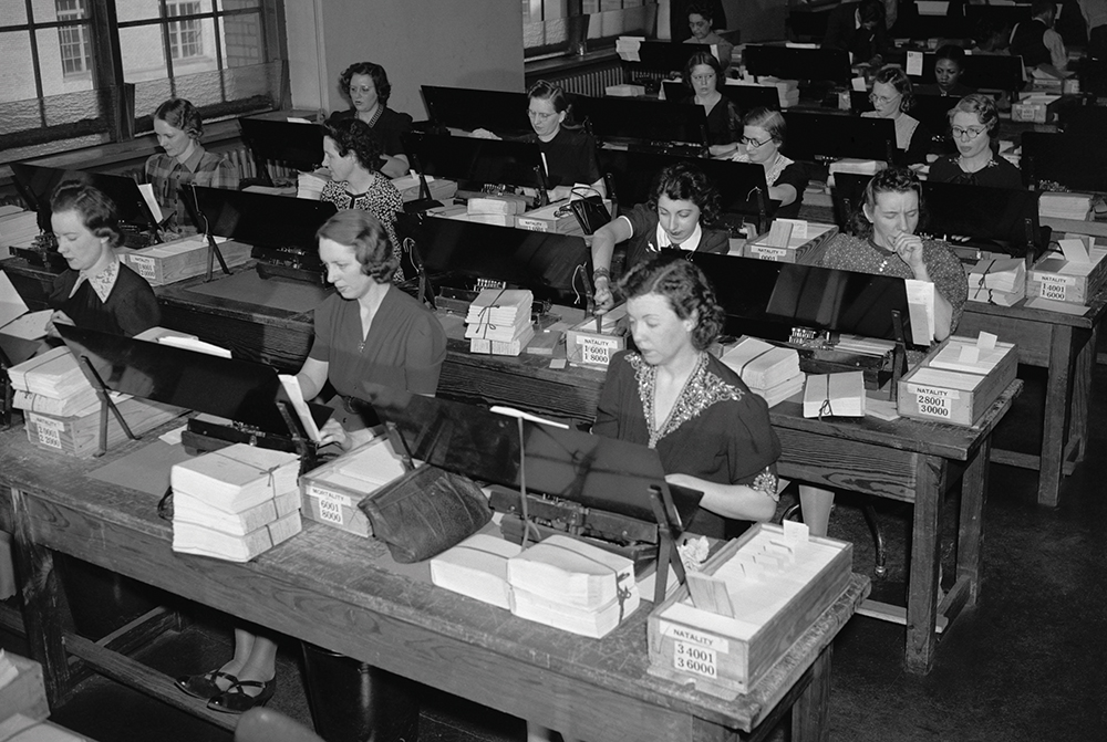 Women U.S. Census workers transferring birth records to computer punch cards, ca. 1940.