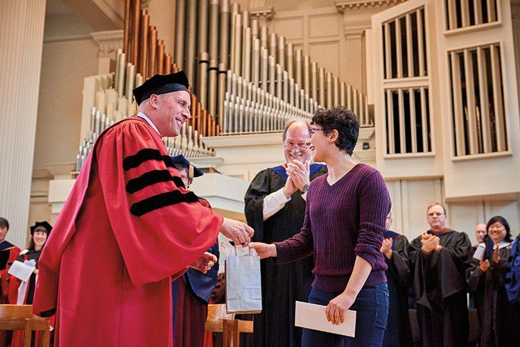 President Brian Casey congratulates student onstage