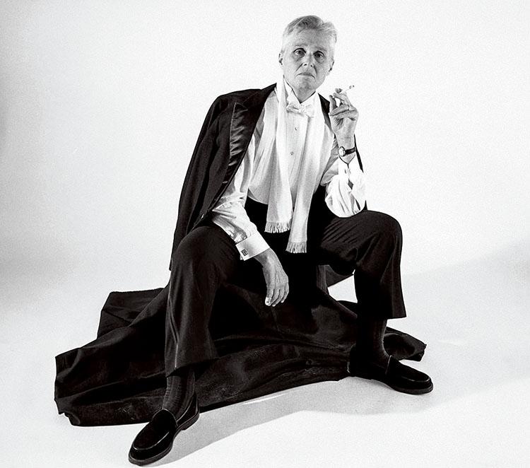 Black and white portrait of Linn Underhill in tuxedo holding cigarette