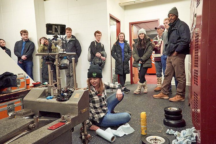 Student interns gather on film set