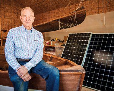 David Borton sitting with Solar panels