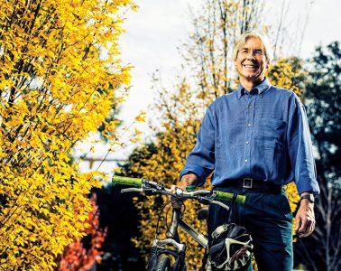 Chris Gardner posing with bike
