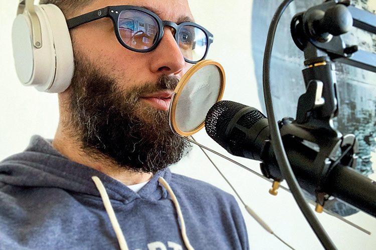 Quinn Emmett 05 speaking into microphone