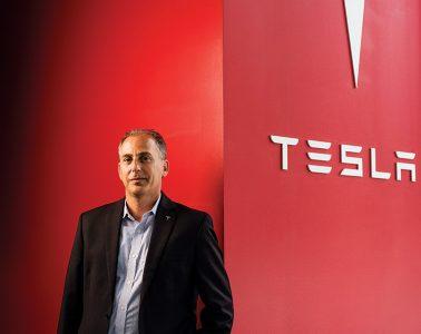 Joe Mendelson with Tesla logo