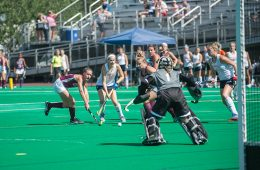 field hockey players attack the goal