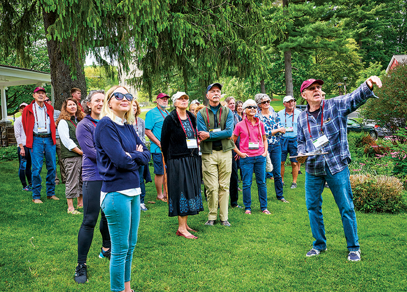 Ron Hoham (far right), biology professor emeritus, leads a walking tour of the campus landscaping.