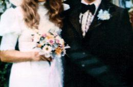 Couple in 70s-style wedding attire