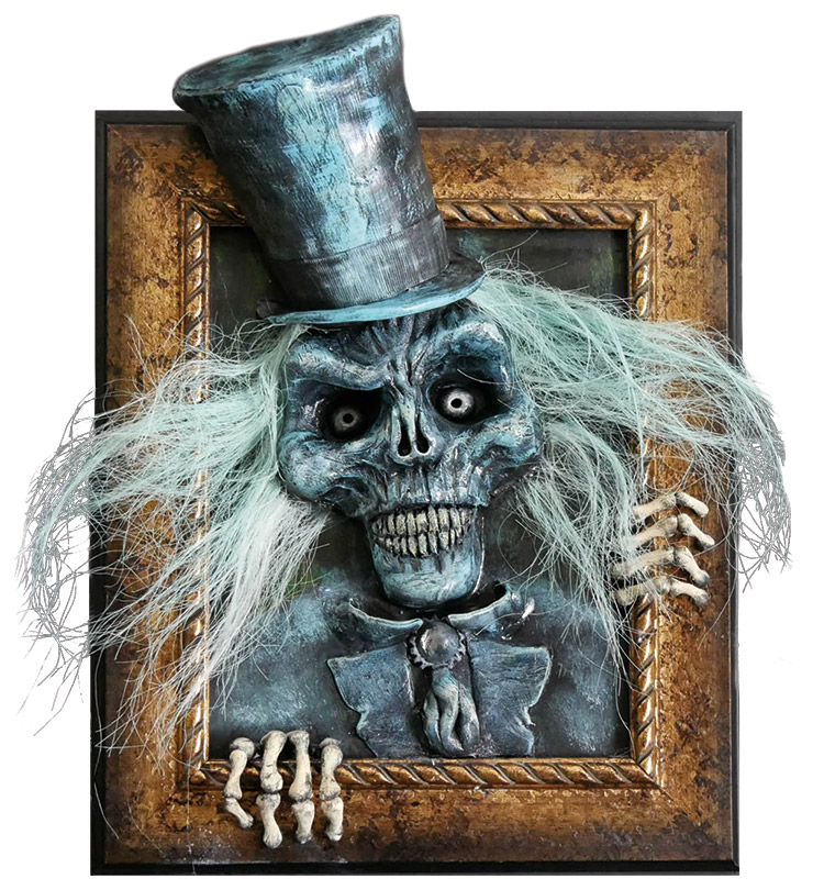 spooky ghoul in top hat bursting out of picture frame