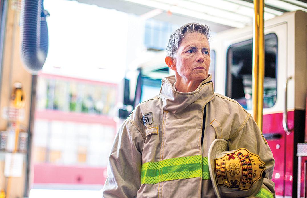 Photo of alumna in her firefighting gear