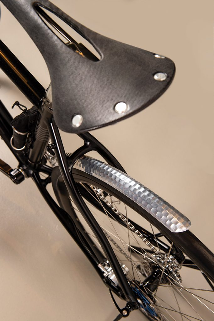 Close up of a black and chrome bike