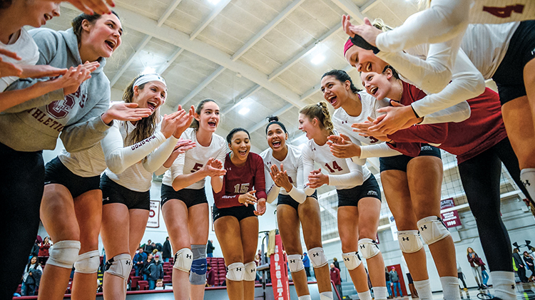 Colgate volleyball team in a huddle