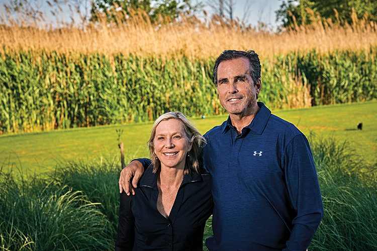 Lee and Bob Woodruff standing in front of cornfield