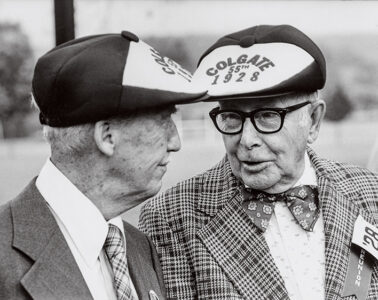 black and white image of two alumni talking