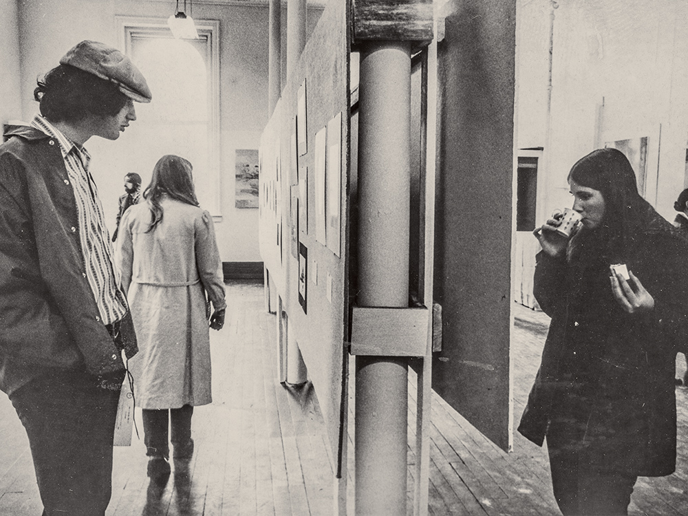 Students looking at a long poster display