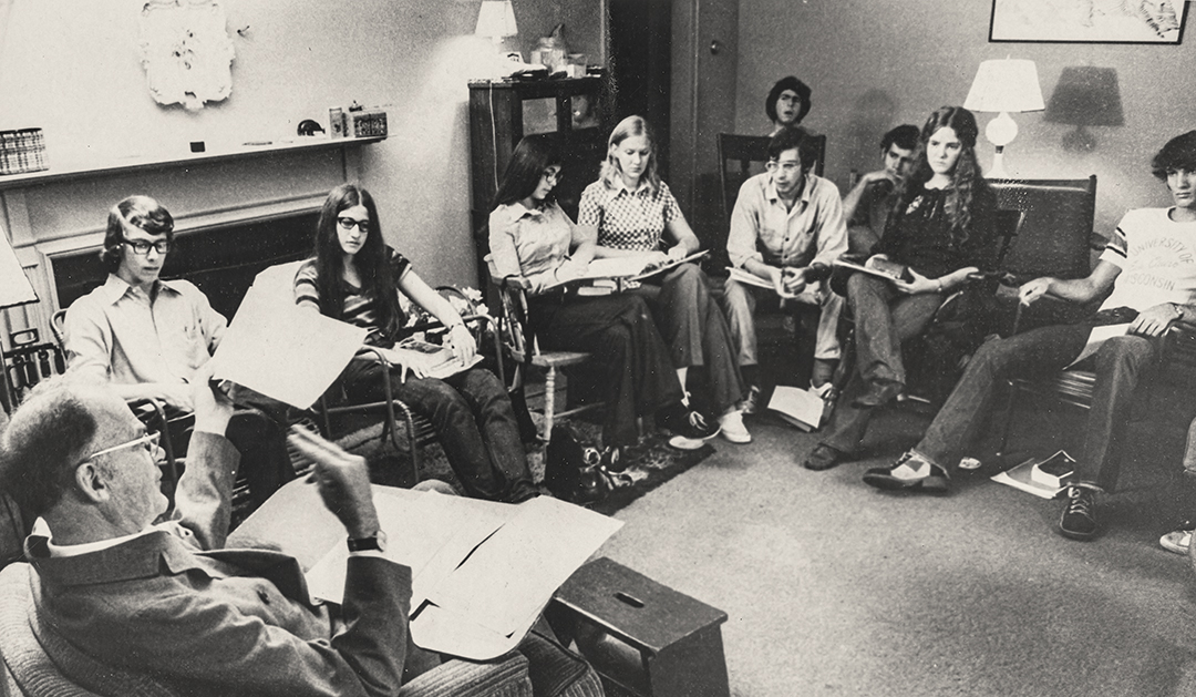 a black and white photo of coed classroom