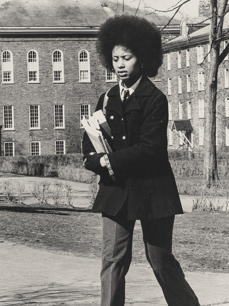 Female student carrying books on campus
