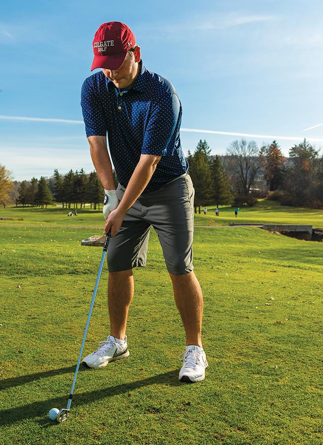 Michael Hanratty '24 playing golf