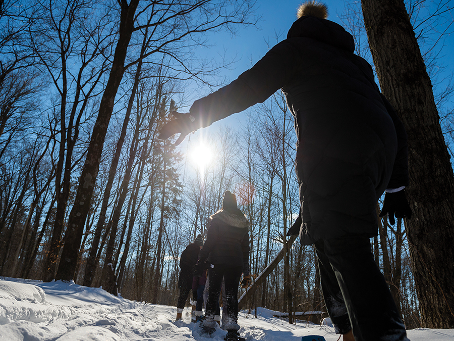 students snow shoeing on snowy trails