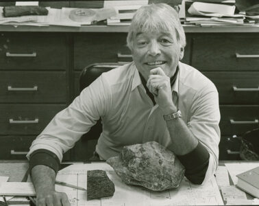 Jim McLelland smiling with some rocks