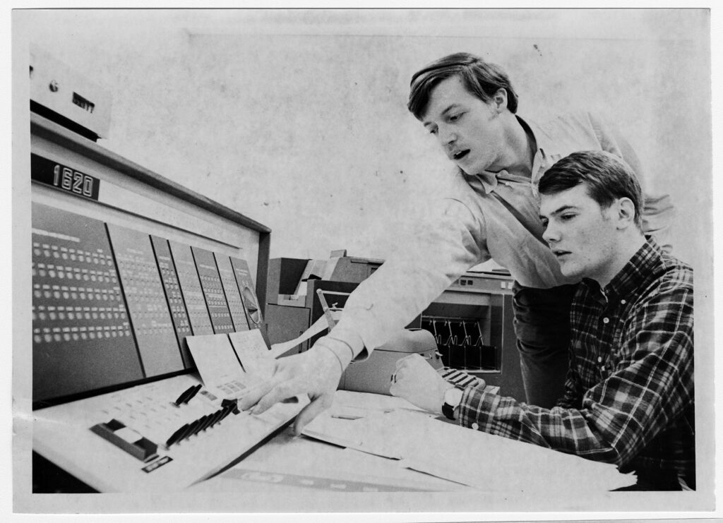 Students working on a computer in the late 1960's.
