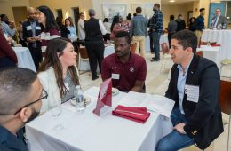 John Paul Ortiz '10 discusses business with students at a Mosaic Weekend event