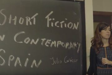 Marta Perez-Carbonell at a blackboard that reads Short Fiction in Contemporary Spain