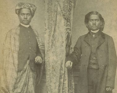 Mirror image of Moung Kyaw in traditional Burmese clothing and western clothing, circa 1865