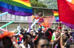 Michael Francis James '17, with the help of his stilts, floats above the crowd at Trinidad and Tobago's first public Pride Arts Festival