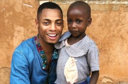 Uyi Omorogbe '19 poses with child