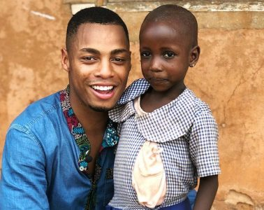 Uyi Omorogbe '19 poses with child