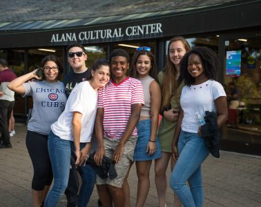 Group of students pose in front of ALANA Cultural Center
