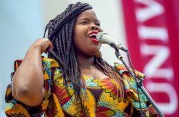 R&B artist Danielle Ponder sings into a microphone