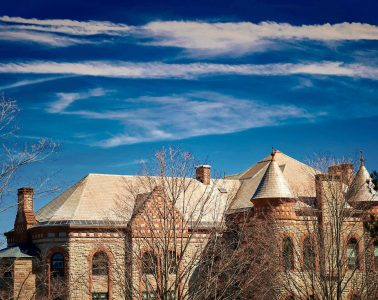 Blue sky over James B. Colgate Hall roofline