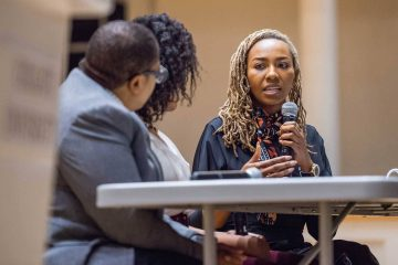 Opal Tometi speaking with a microphone on Chapel Stage