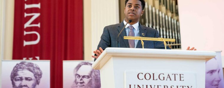 Christian Johns at Colgate University Podium in the Chapel