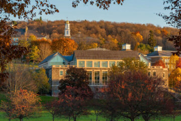 View of Case-Geyer Library and campus hill in autumn