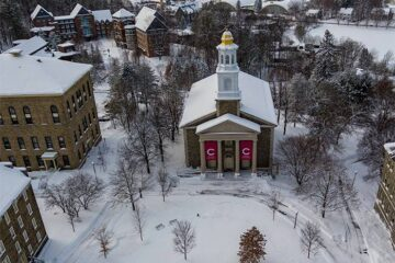 Aerial view of Memorial Chapel and academic quad in the snow