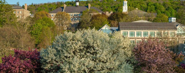 Scenic view of upper campus from below Payne Creek, flowering crabtrees in foreground