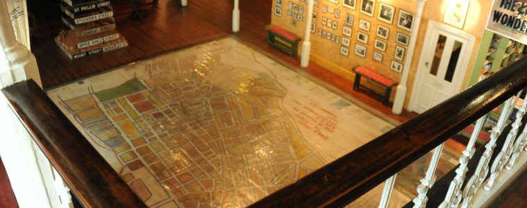 Looking down over a railing at a map on the floor of the District Six Museum