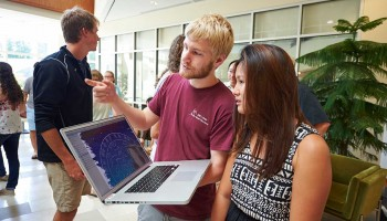 Students look at content on a laptop in Colgate's Ho Science Center