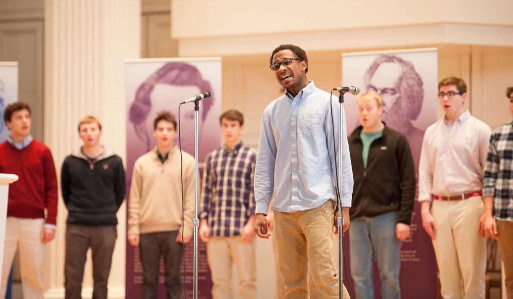 Students singing onstage in the Colgate Memorial Chapel